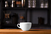 Coffee cup mock up template for logo design display at the bar counter