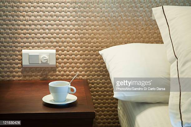 Coffee cup on bedside table