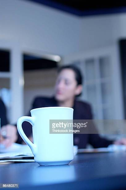 Coffee cup on conference table