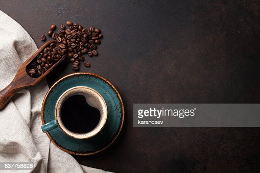 Coffee cup on old kitchen table : Stock Photo