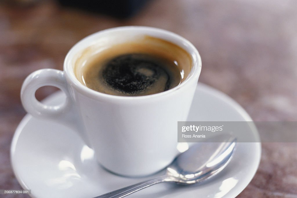 Coffee cup on saucer with spoon : Stock Photo
