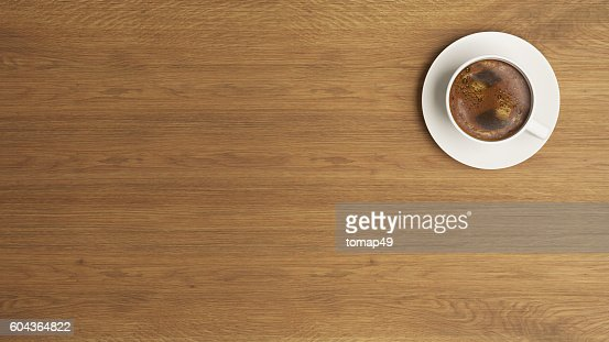 coffee cup on the wooden desk concept : Stock Photo
