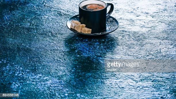 Coffee cup over blue