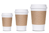 Photograph of three coffee cup sizes isolated on white background.