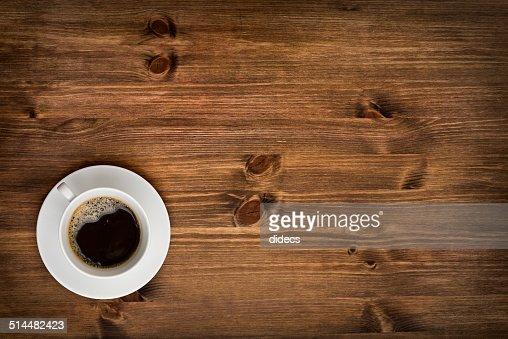 커피잔을 상단 보기 배경기술 나무 탁자 : 스톡 사진