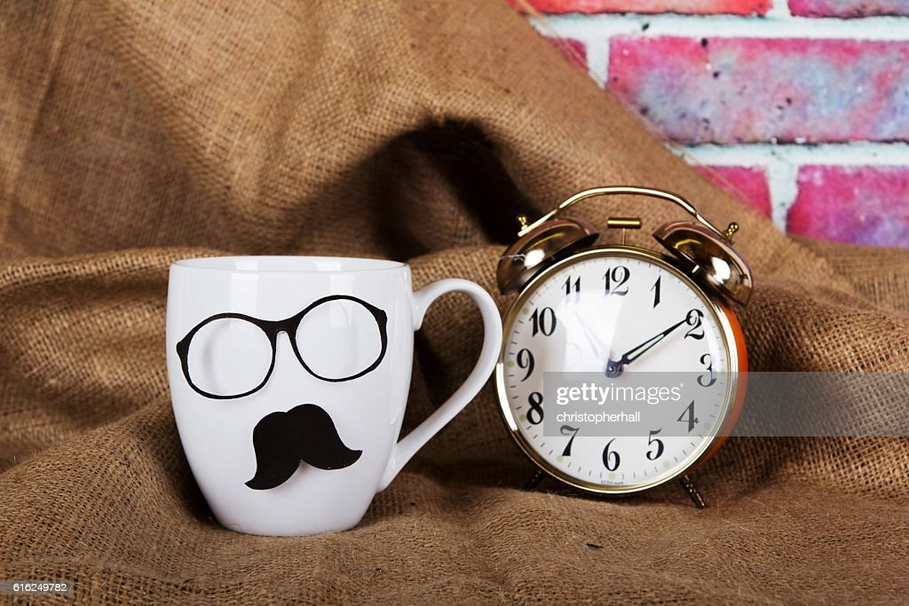 Coffee cup with a black hipster mustache : Stock Photo