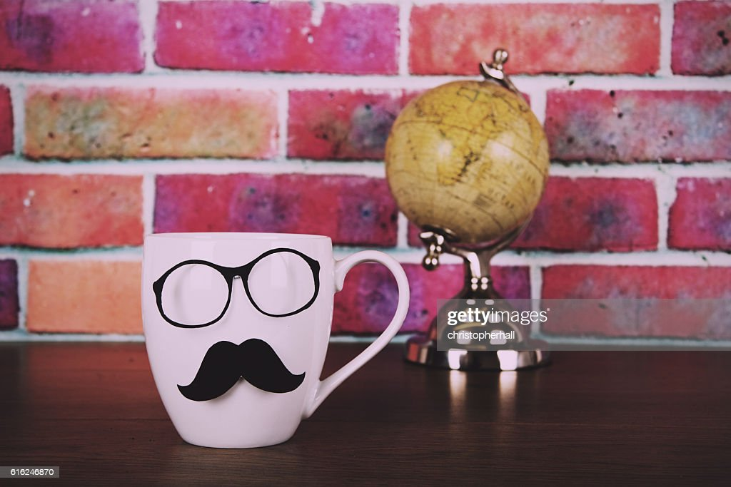 Coffee cup with a black hipster mustache  Vintage Retro : Stock-Foto