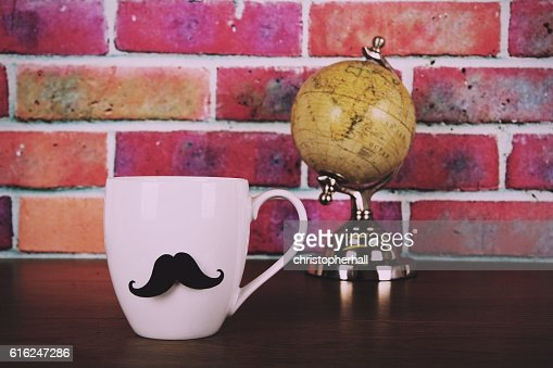 Coffee cup with a black hipster mustache  Vintage Retro : Foto stock
