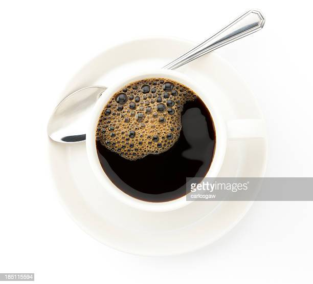Coffee cup with a silver tea spoon on white background