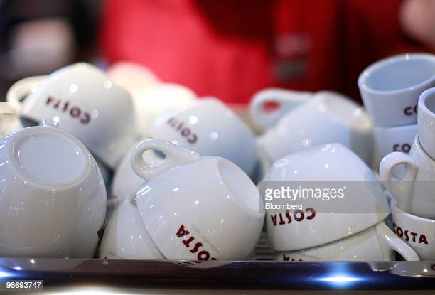 Coffee cups are seen in a Costa Coffee shop in London UK on Monday April 26 2010 Whitbread Plc which own Costa Coffee announce earnings on Thursday...
