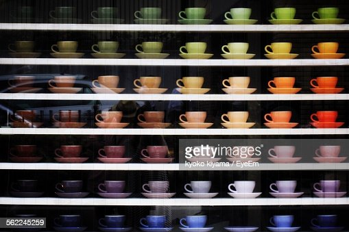 Coffee Cups Arranged On Display Window For Sale In Store