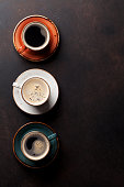 Coffee cups on old kitchen table. Top view with copyspace for your text
