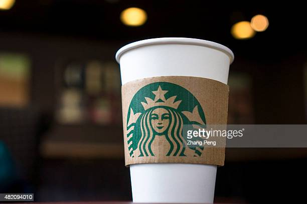 Coffee cups on the table in a Starbucks shop Last Thursday Starbucks Corp announced a new partnership with Lyft which is Uber's biggest competitor...