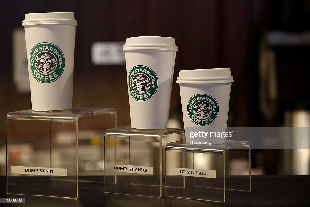 Coffee cups sit on display inside the Dumb Starbucks Coffee store, a parody of the Starbucks Corp. coffee chain, in Los Angeles, California, U.S., on Monday, Feb. 10, 2014. Dumb Starbucks, which opened this past weekend, offered Dumb Vanilla Blonde Roast, Dumb Chai Tea Latte, and Dumb Caramel Macchiato, all available in sizes Dumb Venti, Dumb Grande, and Dumb Tall. Photographer: Patrick T. Fallon/Bloomberg via Getty Images