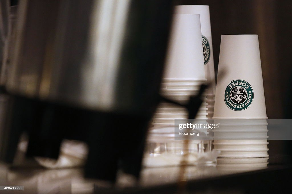 Coffee cups sit stacked at the Dumb Starbucks Coffee store, a parody of the Starbucks Corp. coffee chain, in Los Angeles, California, U.S., on Monday, Feb. 10, 2014. Dumb Starbucks, which opened this past weekend, offered Dumb Vanilla Blonde Roast, Dumb Chai Tea Latte, and Dumb Caramel Macchiato, all available in sizes Dumb Venti, Dumb Grande, and Dumb Tall. Photographer: Patrick T. Fallon/Bloomberg via Getty Images