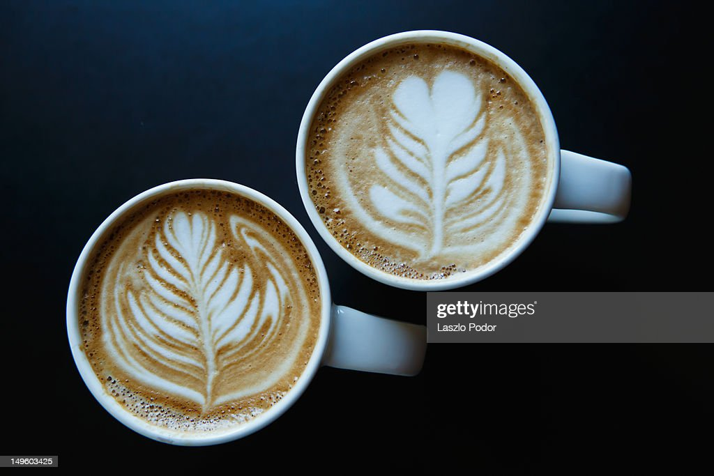 Coffee delight with latte art : Stock Photo