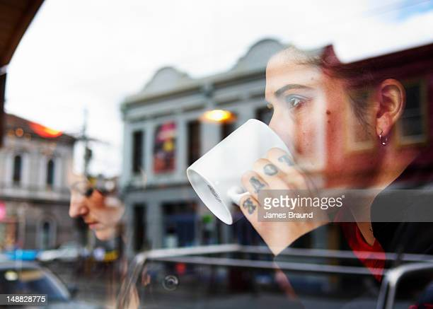 Coffee drinker with 'Love' tattoo on Brunswick Street, Fitzroy.
