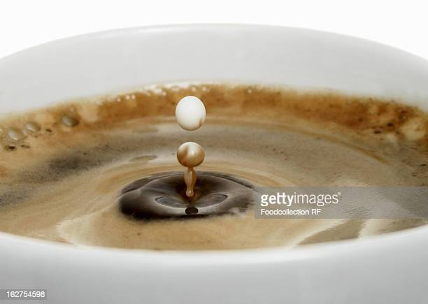Coffee drops in cup