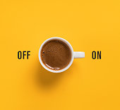 Cup of coffee on yellow background like switch button