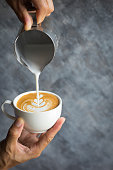 Barista making cafe latte art in coffee shop with blank space for wording
