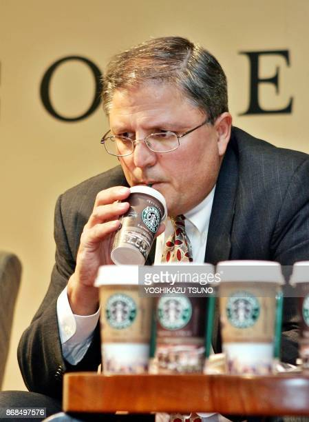 US coffee giant Starbucks senior vice president Gerardo Lopez drinks a chilled packaged coffee drink called 'Starbucks Discoveries Milan ' at a press...