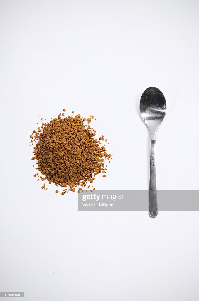Coffee granules and spoon