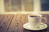 Coffee cup on a day window background
