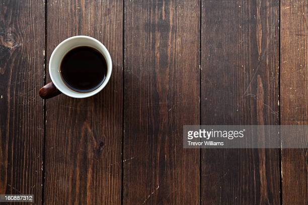 Coffee in a mug on a wooden floor