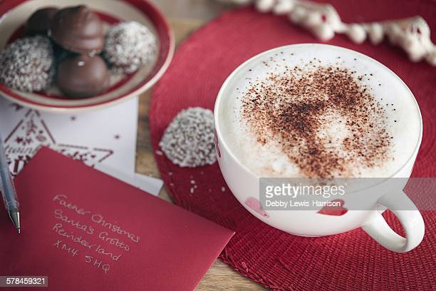 Coffee, Invitation card and coconut-coated chocolate