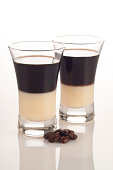 Two Coffee Liquor on Reflective White Background.