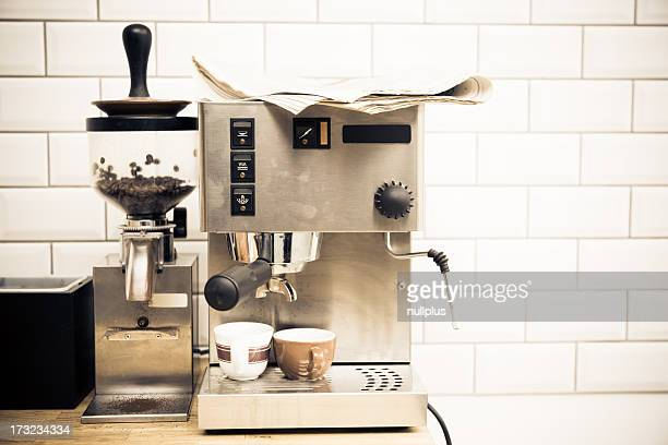 coffee machine with newspaper