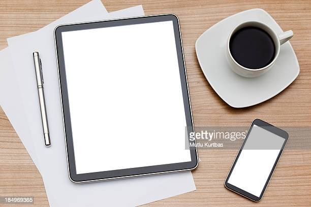 Coffee mug with tablet computer and smartphone