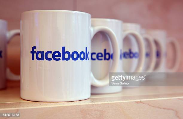 Coffee mugs adorned with the Facebook logo stand at the Facebook Innovation Hub on February 24 2016 in Berlin Germany The Facebook Innovation Hub is...