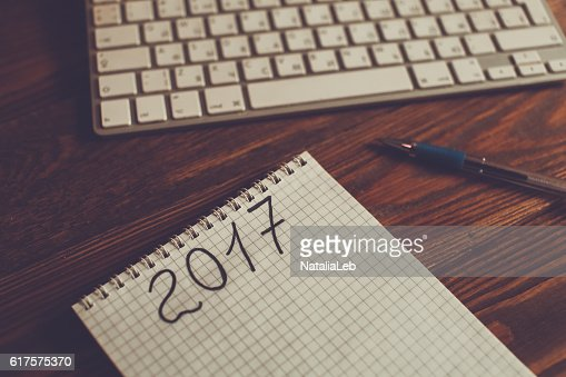 Coffee, notebook and keyboard on a dark wooden table : Stock Photo