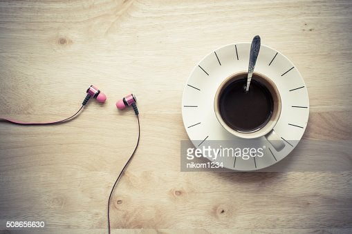 Coffee on the table and headphones. : Stock Photo