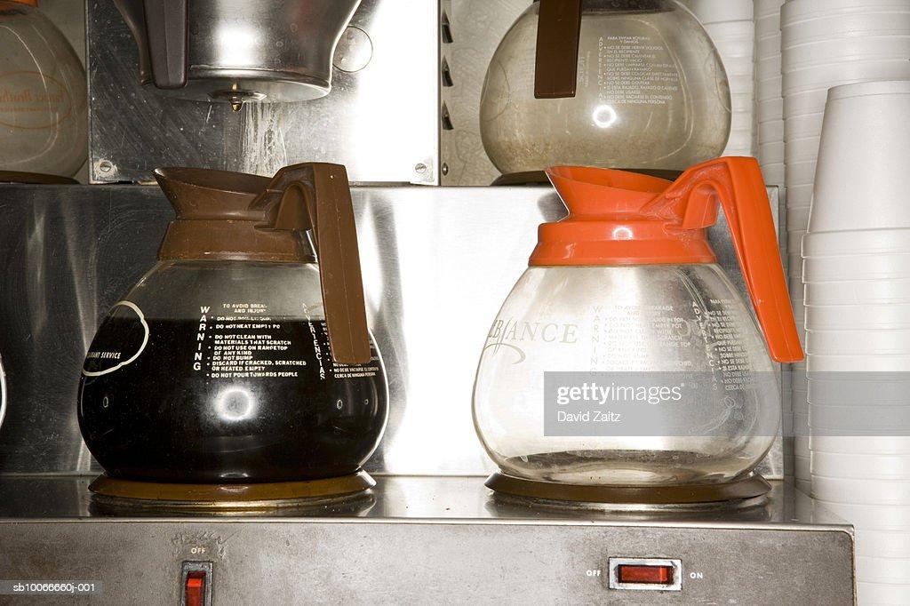 Coffee pots on brewing machine, close-up