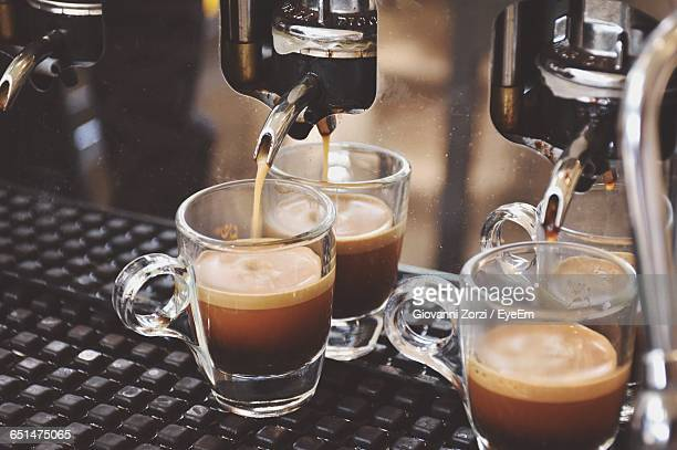 Coffee Pouring From Machine In Cups