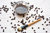 Homemade coffee scrub made out of coffee, honey and milk for skin care