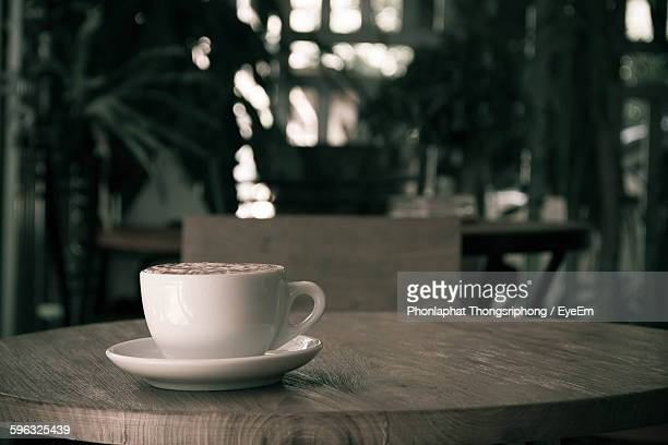 Coffee Served On Wooden Table At Restaurant