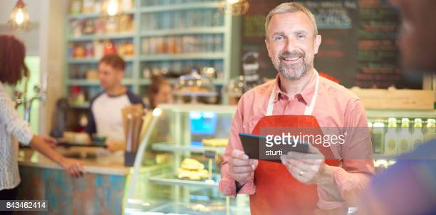 coffee shop owner checking his online accounts