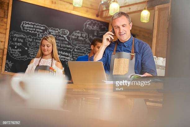Coffee shop owner phoning accountant
