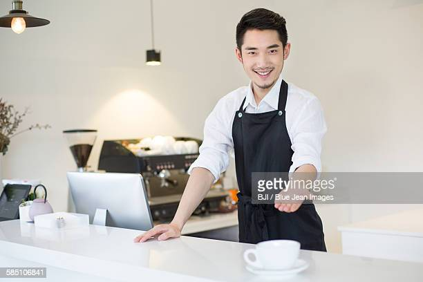 Coffee shop owner working