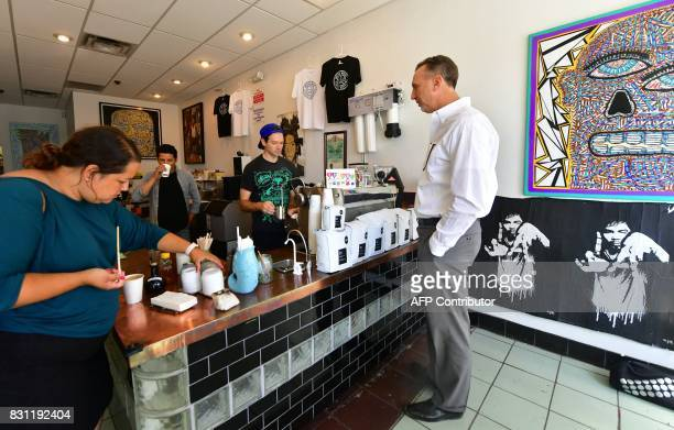Coffee shop owners Mario Chavarria and Jackson Defa working the machine talk with customers at their Weird Wave Coffee Brewers in the Boyle Heights...