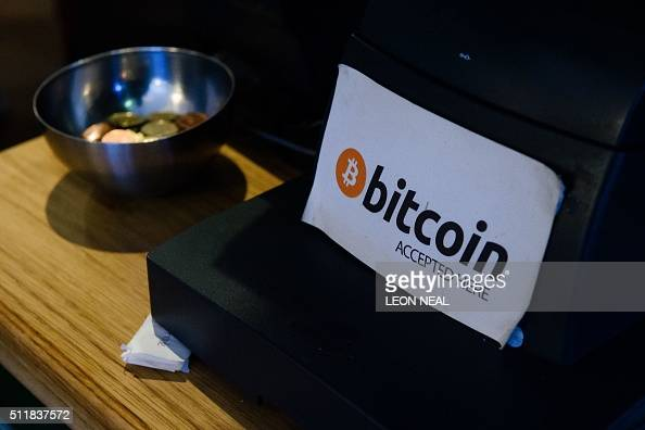 A coffee shop sign advertises that the digital currency 'Bitcoin' is accepted in central Dublin on February 23 2016 / AFP / LEON NEAL
