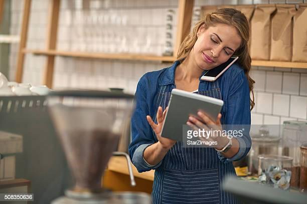 Coffee shop worker making online order
