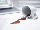 Coffee spilled on office desk