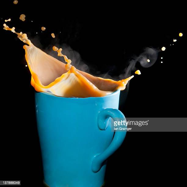 Coffee splashing out of blue mug