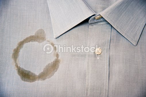 Coffee Stain On A Clean And Folded Shirt Stock Photo