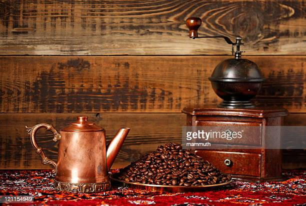Coffee still life with beans and grinder