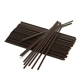 An isolated group of disposable coffee stir sticks that you would find at most cafes.